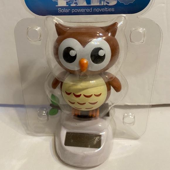 Solar powered dancing brown owl figuire